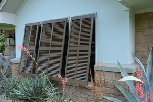 Bahama style shutters on home